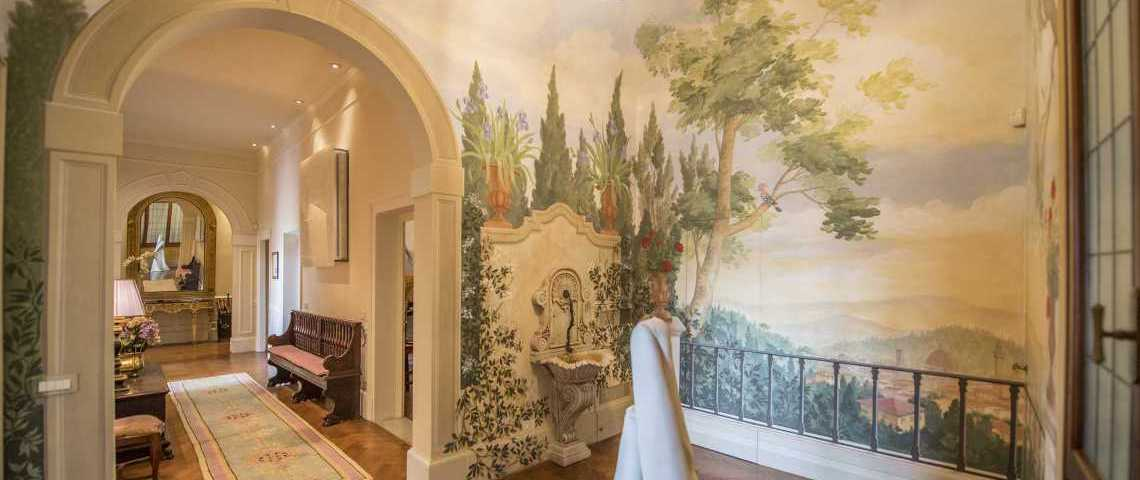 The frescoed room at the end of the main hallway: the skyline of Florence is well visible behind the railing and the trees contributes in creating the illusion of being outdoor