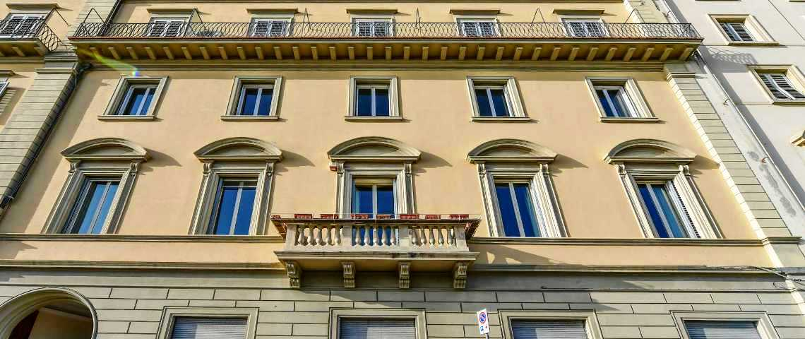 The façade of the palazzo, with the apartment easily recognizable by the central balcony and the tympaned windows